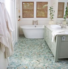 Enjoy a natural stone pebble bathroom floor with the King Pebble 16x16 Natural Stone Collection in Flores Green. A mix of pebble the much larger and flatter pebbles are selected and interlocked to create a seamless, visually impressive surface perfect for walking on! Starting at $20.68 SQ FT this is a popular choice for both residential and commercial properties!
