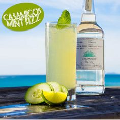 CASAMIGOS MINT FIZZ  1 1/2 parts Casamigos Blanco Tequila.  3/4 part fresh lime juice.  1/2 part agave nectar.  8 to 10 mint leaves.  3 to 4 thin cucumber slices.  Club soda.   Combine mint, cucumbers, and lime juice and put it in a shaker. Lightly press the mint leaves into the lime juice with a muddler, add tequila, shake, and double-strain over ice in a Collins glass. Top with club soda. Garnish with mint sprig.