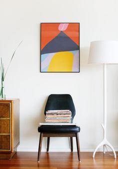 bold art print, white lamp on white wall