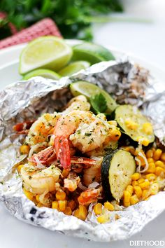 Grilled Coconut Lime Shrimp and Summer Veggies in Foil by diethood: Corn, zucchini and coconut-lime marinated shrimp grilled in foils makes for one easy, delicious, 30-minute summer dinner. #Shrimp #Corn #Zucchini #Coconut #Lime #Foil #Healthy #Easy