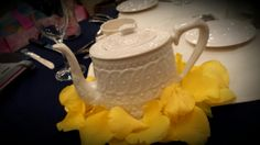tea pots in many styles make for unique centerpieces!