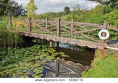 Wooden Bridge Over Water With Life Ring