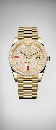 The new Rolex Day-Date 40 in 18 ct yellow gold with a bezel set with 48 brilliant-cut diamonds and a dial entirely paved with 721 diamonds. The hour markers are composed of eight baguette-cut diamonds and two baguette-cut rubies at 6 and 9 o'clock. #RolexOfficial #Baselworld2016