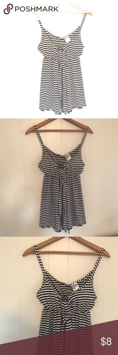 Black and white striped tank (juniors) Black and white striped tank top with a sash. 100% cotton. EUC  *juniors large Tops Tank Tops