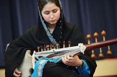 Afghanistan's first female conductor, 17-year-old Negin Khpolwak