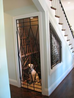 Another great use of space under the stairs a wine room storage area