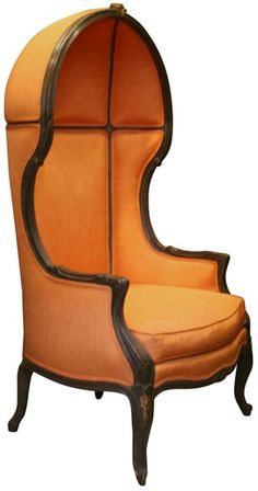 Orange porter's chair. Historically this kind of canopy chair was used by hall porters to protect themselves from draughts and currents of cool air #canopychair #concierge #interiordesign - More wonders at www.francescocatalano.it