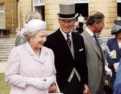 Britain's Queen Elizabeth II and Duke of Edinbugh with the Prince of Wales at a Garden Party at Buckingham Palace