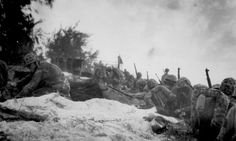 """""""Negro assault troops await orders D-day to attack enemy shortly after they had come ashore at Saipan in the Marianas."""" June 1944 127-N-83928. -"""