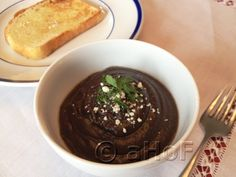 Guatemalan recipe ~ Frijoles Colados (Pureed Black Beans ), with a sprinkling of Cotija Cheese and Parsley. Add eggs and classics Guatemalan breakfast. Guatemalan Recipes, Guatemalan Food, Great Recipes, Favorite Recipes, Good Food, Yummy Food, Healthy Dishes, Healthy Eats, Latin Food