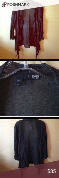 Eileen Fisher wrap sweater XS. Eileen Fisher wrap sweater. Super light weight and very stylish. Mangled. Fabric is a dark grey with a blend of cotton, silk, cashmere  & metallic. No buttons or closures. A great go to piece.  Price is firm. Eileen Fisher Sweaters Cardigans