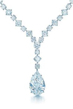 Diamond Necklace Glamour arrives with the sudden and breathtaking appearance of Tiffany diamonds. Necklace with a pear-shaped diamond drop in platinum. - Ring in platinum and gold with a blue tourmaline. Bling Bling, Tiffany Jewelry, Diamond Pendant Necklace, Diamond Jewelry, Drop Necklace, Diamond Rings, Platinum Jewelry, Diamond Necklaces, Platinum Ring