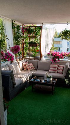 Love the plants and furniture! Could do without the green rug.