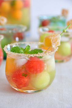 Melon Rumballa  (•3–4 ripe melons, depending on size  •1/2 liter white rum  •1 bunch fresh mint, cleaned and stemmed  •3 limes juiced  •8 oz ginger soda  •8 oz coconut water  •whole vanilla beans  •candied ginger (for garnish)  •sugar for rimming the glasses)
