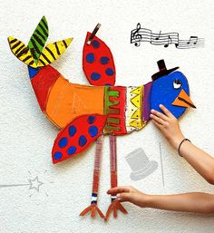 DIY Big Cardboard Birds, a colorful painted craft art activity for kids.