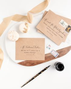 Gold and Black Envelope Calligraphy by Laura Hooper | Beautiful White Ink on Black Envelopes |
