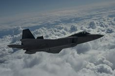 An F-22 Raptor from the U.S. Air Force 525th Fighter Squadron performs a refueling mission with a KC-135 Stratotanker from McConnell Air Force Base, Kan., outside of Joint Base Elmendorf-Richardson, Alaska, during a training mission, Aug. 7, 2014. The F-22 is designed to project air dominance, rapidly and at great distances. (U.S. Air Force photo by Staff Sgt. Stephany Richards/ Released)