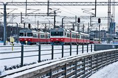Sm2 and Sm1 trains departing from Helsinki railway station in Helsinki, Finland