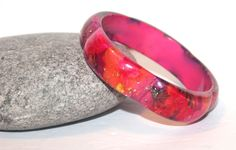 Check out this item in my Etsy shop https://www.etsy.com/listing/218536629/floral-sparkle-pink-acrylic-bangle