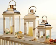 10 Pillar Candle Holder Display Ideas with a Beach and Coastal Theme