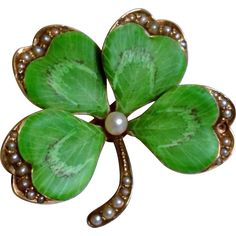 Circa 1900, Four Leaf Clover or Shamrock in 14K yellow gold. The attention to extreme detail and quality construction are evident. The textured petals