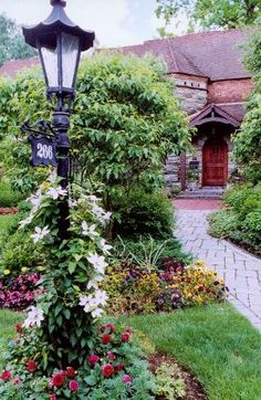 I like the idea of a light pole with the street number. Front yard landscape design by Antonella Fanelli
