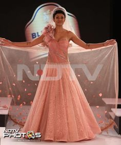 Sushmita Sen for Mandira Wirk in a peach coloured bridal outfit