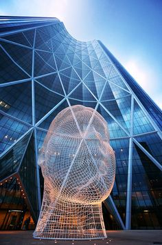 Wonderland, a tall wire-frame sculpture created by designer Jaume Plensa, is located in front of the Bow Tower in downtown Calgary, AB Canada. Calgary, Vancouver, Alberta Canada, Architecture Cool, Belle Villa, Best Cities, Canada Travel, Banff, Oeuvre D'art
