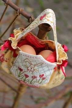 Do put your eggs in one basket. Cute bunny bag. Not sure if you should hang it on an iron fence though...