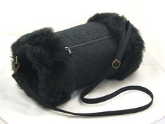 A vintage style hand muff\/warmer that features a zippered pocket.  A beautiful cold weather accessory.  This hand muff is made from a high