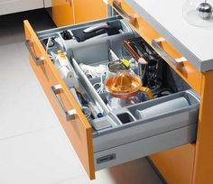Pull-out kitchen workstation in a drawer #2: this one has outlets and cord management for small appliances