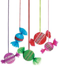 use foam balls and wrapping paper then trim with ribbon-hang over door