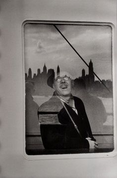 Henri Cartier-Bresson - Makes your eye move around the picture, you focus in and out from the man behind the glass and the reflection. This is a man's - an immigrant's - first sight of America and his future...