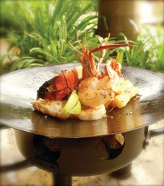 Seafood parillada with spiny lobster, langoustines and shrimp congrio ~ fish from Puntarenas, Costa Rica.  Served fresh at Papagayo restaurant at Four Seasons Costa Rica.