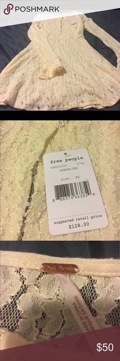 Free People NWT White Shearling Dress, XS Super cute Free People dress, XS.  Flared sleeves, cut out in the middle of the chest, zipper on the right side. Free People Dresses Mini