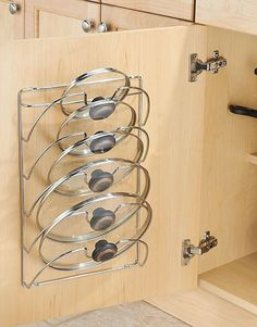 Organize your pot lids on this pretty steel rack to clear your cabinets of clutter. Cabinet Lid Rack. NNT #organize #ad #organizing #kitchenorganization #kitchens #organisation