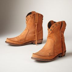 """NEW FRONTIER BOOTS--Meet the best of the West in these moccasin-inspired boots with a western shaft, studs and fringe, in softest nubuck leather. Imported. Whole and half sizes 6 to 10, 11. 2"""" heel."""