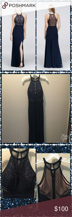 Gorgeous navy blue cocktail dress. This dress is classy and elegant. Beautiful and sexy, but classy evening gown. Floor length with a slit up one side, with a sheer back. This dress has not been altered. New with tag from David's Bridal. This dress would be perfect for a prom or a wedding. David's Bridal Dresses