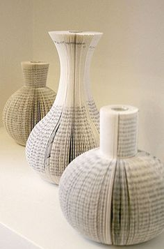 These vases are simple yet beautiful.  The cutting was done flawlessly and really made the design work.  This also looks simple to achieve, as long as you get every cut to look exactly the same.