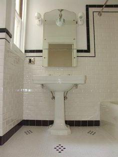 Subway tile 1940's bathroom.                       Like subway tile with border on top and bottom