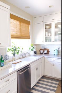 Cozy cottage home tour - love the white kitchen and glass front cabinets eclecticallyvintage.com