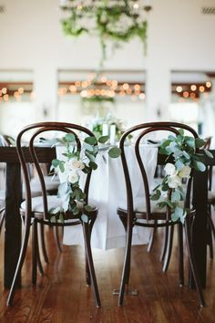 bentwood dining chairs with floral accents | Bel-Air Ballroom Wedding with Shades of Green