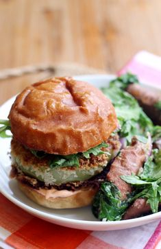 A unique spin on classic fried green tomatoes, these fried green tomato burgers give them an Asian twist with a miso-dressed mizuna and sweet potato salad!