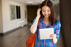 Asian student using digital tablet Royalty Free Stock Photo