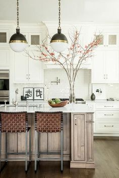 I am NOT a lover of this gray trend--but this island is an exception. It's almost a silver gray, and looks beautiful set again the white cabinets.