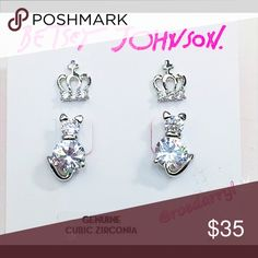 Betsey Johnson Silver CZ Earrings Two pair of trendy silver tone earrings. One cat stud pair CZ and one crown stud pair CZ . Betsey Johnson Jewelry Earrings