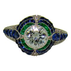 Handmade Platinum, Diamond, Sugarloaf Emerald & Sapphire Ring - WOW there are not many pieces of jewelry that I think I HAVE TO HAVE.....this is beautiful and way out of my grasp!