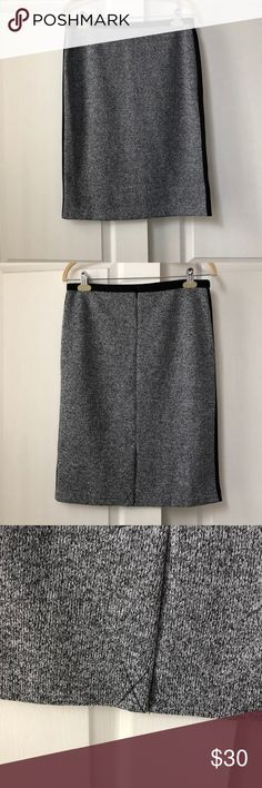 """NWT Calvin Klein gray skirt! Size 8 Gorgeous NWT Calvin Klein gray polyester skirt with 1"""" black fabric stripe down each side, size 8. Dress this skirt up with high black boots, or pumps- can be worn with multiple shirts/blazers- very versatile!  **Don't forget about my bundle option!** Calvin Klein Skirts"""