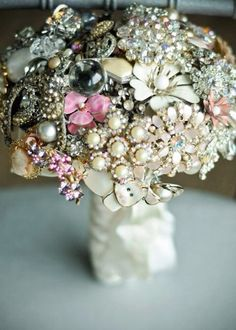 Flower arrangement made with vintage jewelry. Very cool.