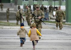 A serviceman runs to meet his children after a farewell ceremony at the Vaziani military base outside Tbilisi, Georgia, March 24, 2015. According to Georgia's Defence Ministry, the 43rd battalion from the IV mechanized brigade of the Georgian Armed Forces is departing to Afghanistan to join a NATO-led mission called Resolute Support. REUTERS/David Mdzinarishvili